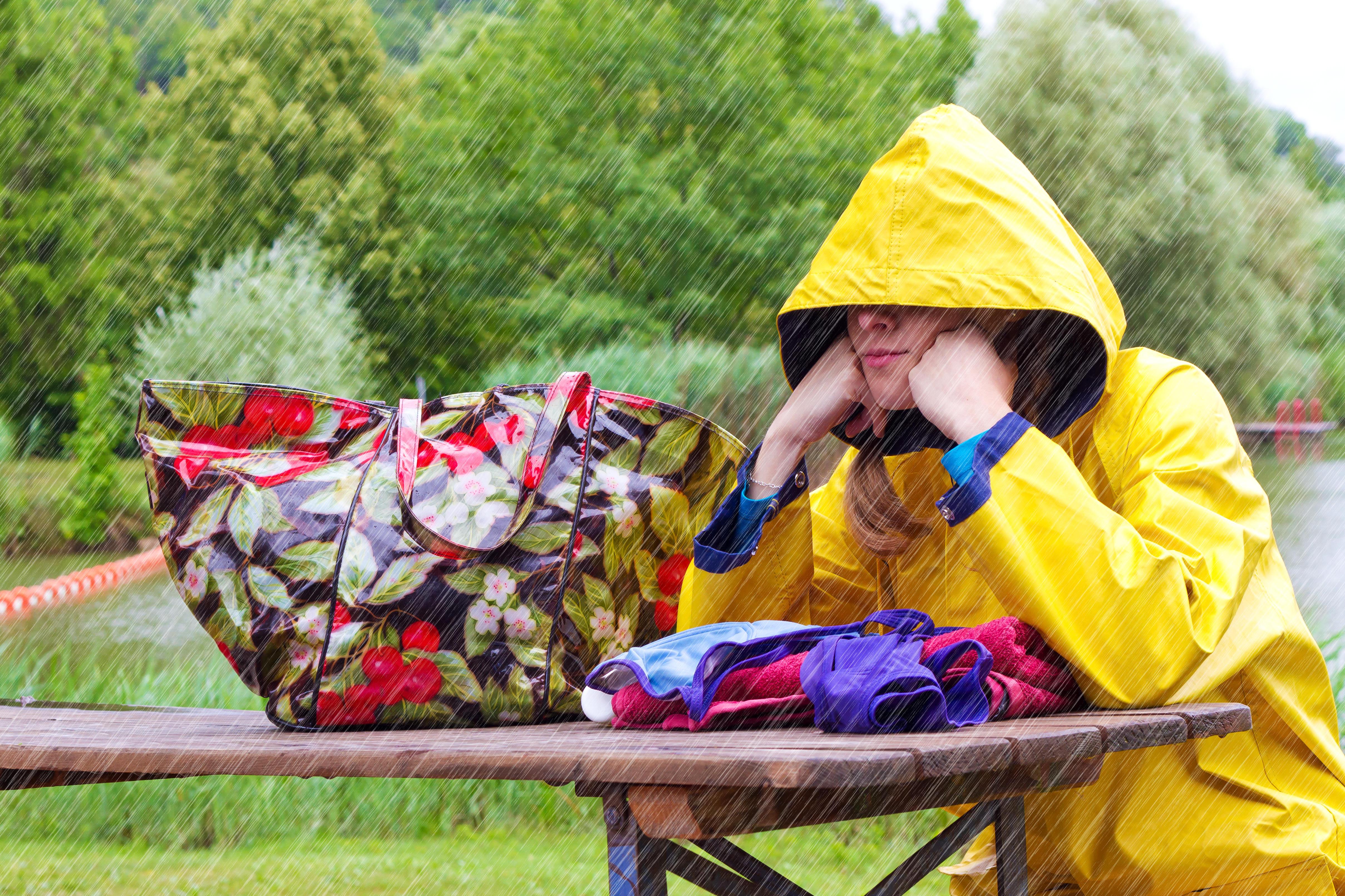 woman sitting outside in the rain