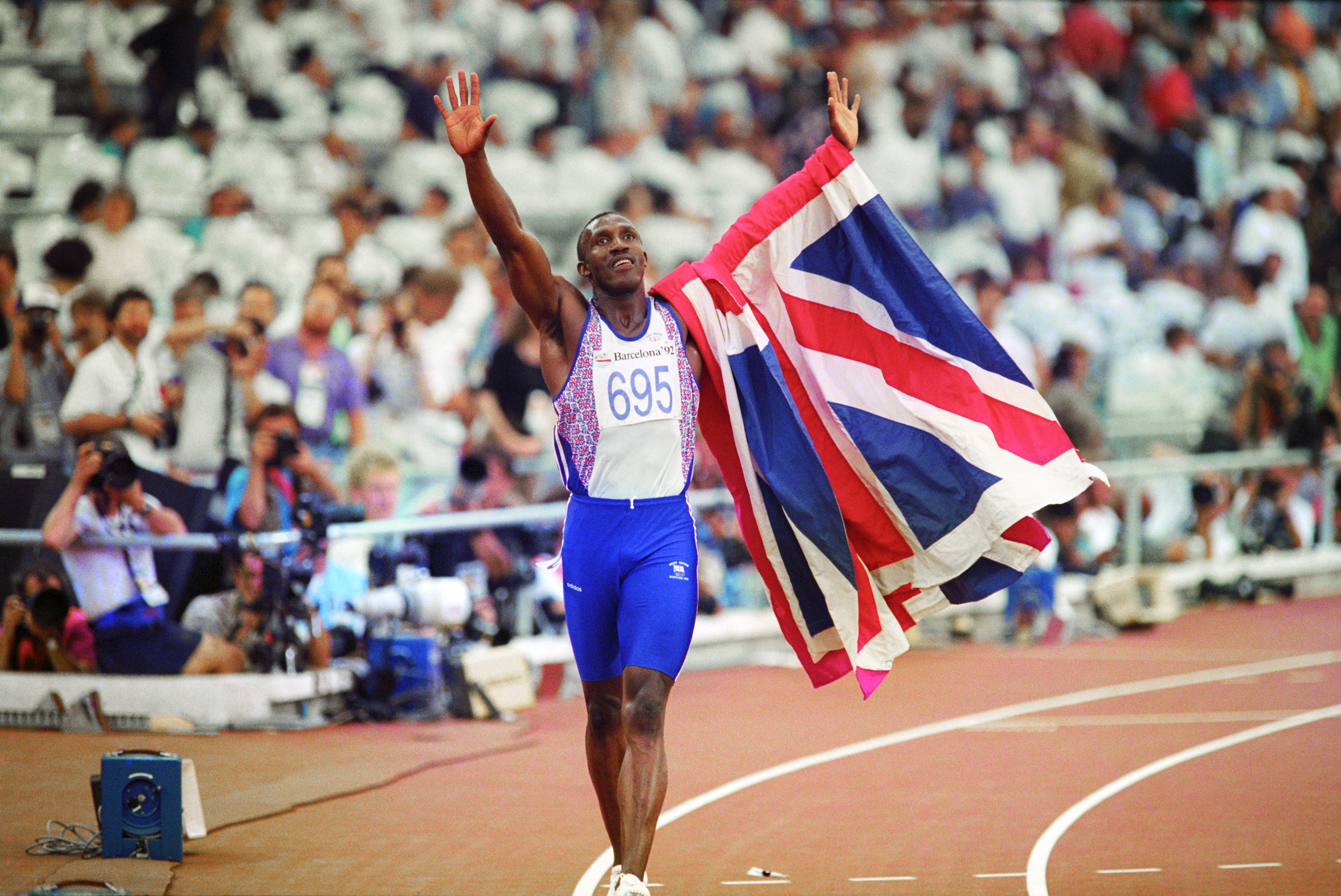 Linford Christie celebrates victory in the 100m final at the 1992 Olympics