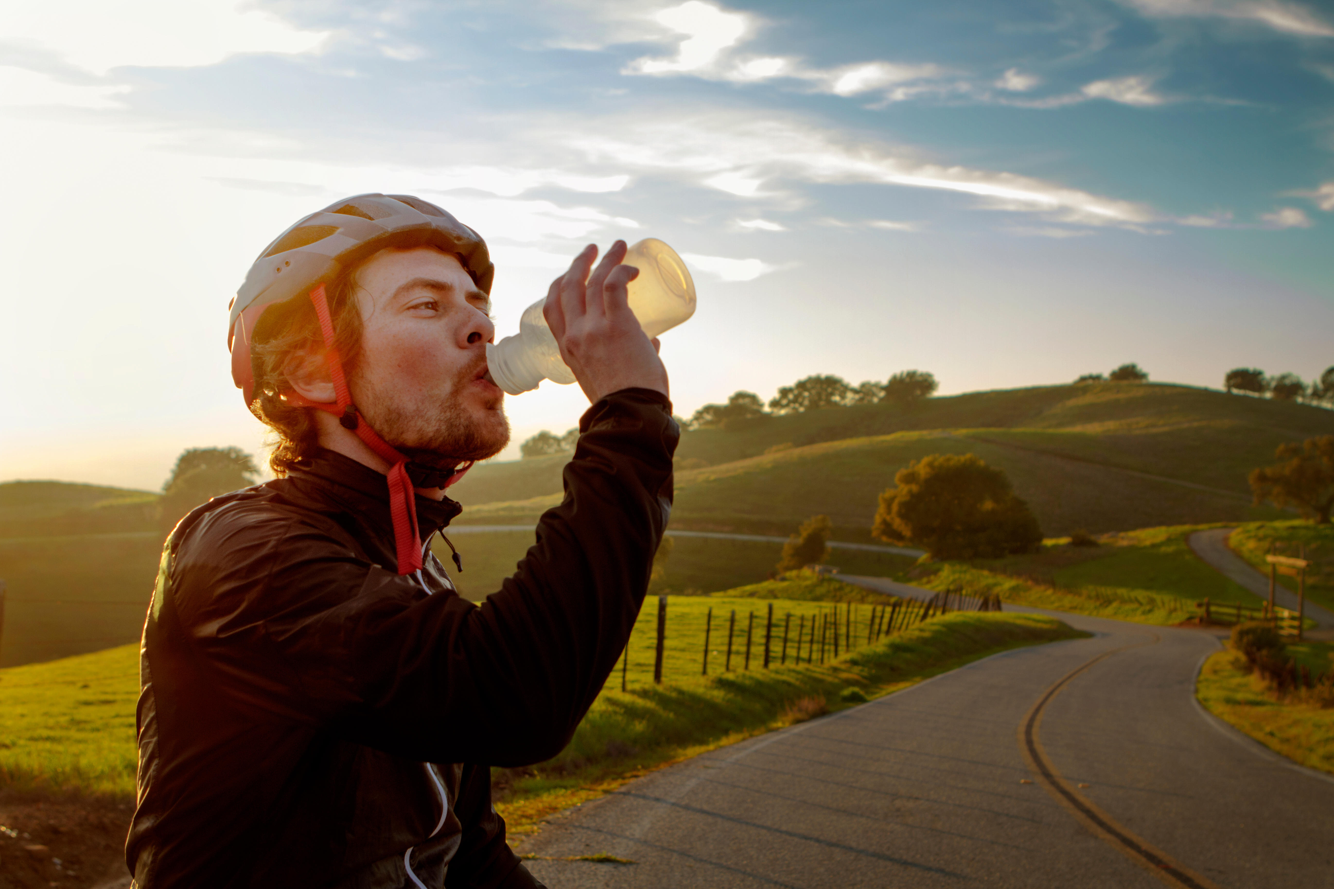 Cyclist having a drink