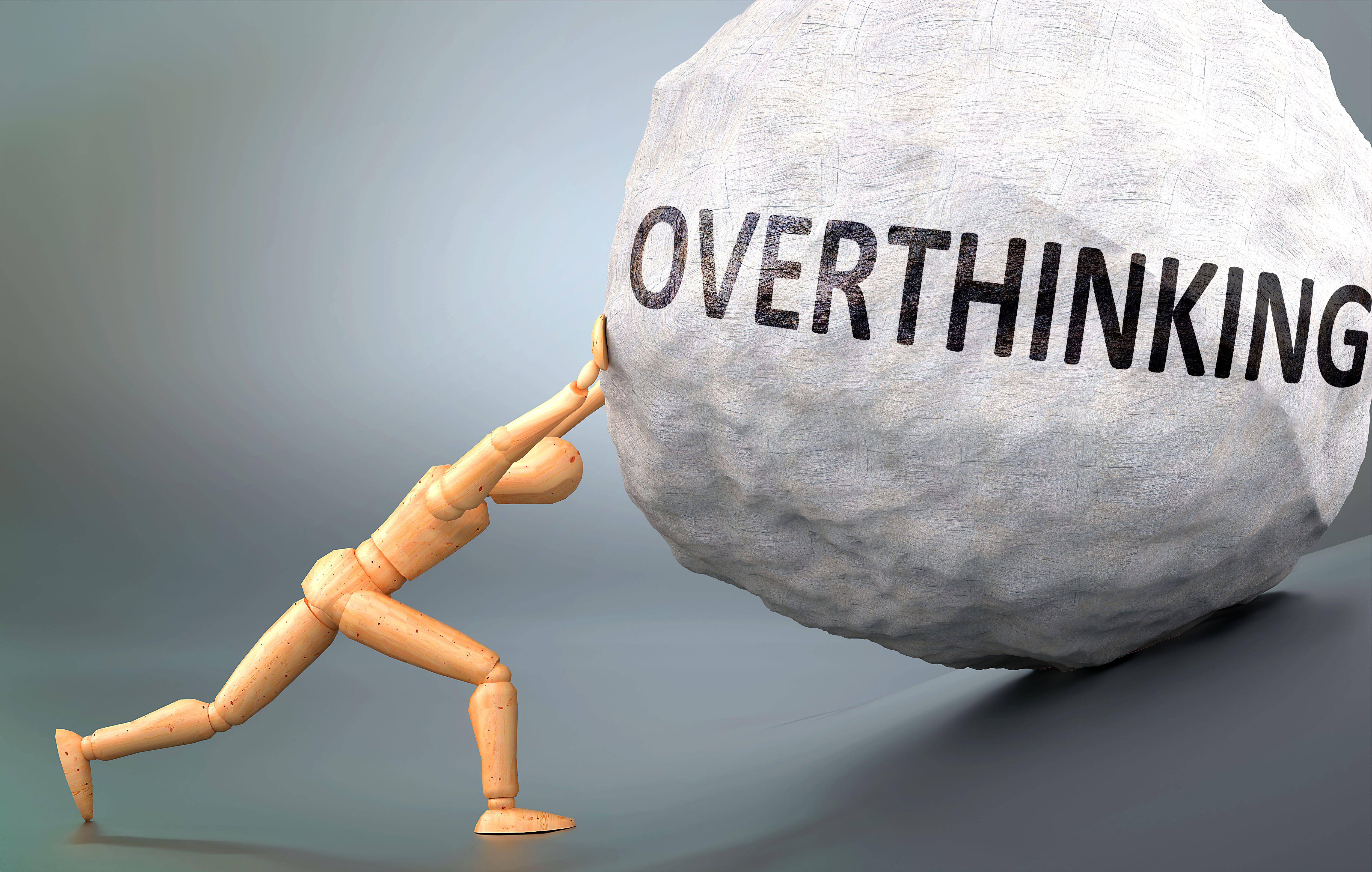 stick figure pushing a boulder labelled 'overthinking'