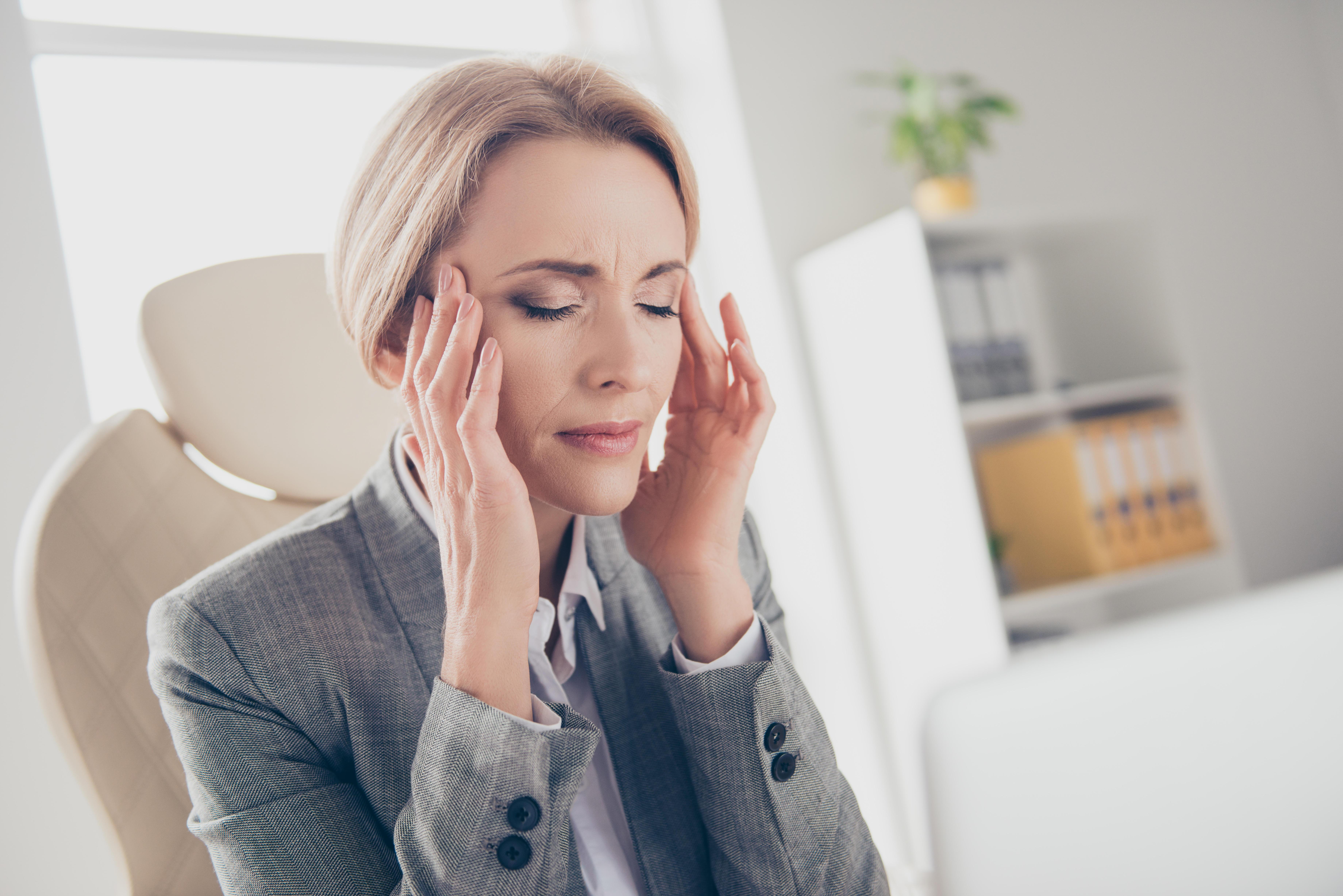 a woman with a headache (Alamy/PA)