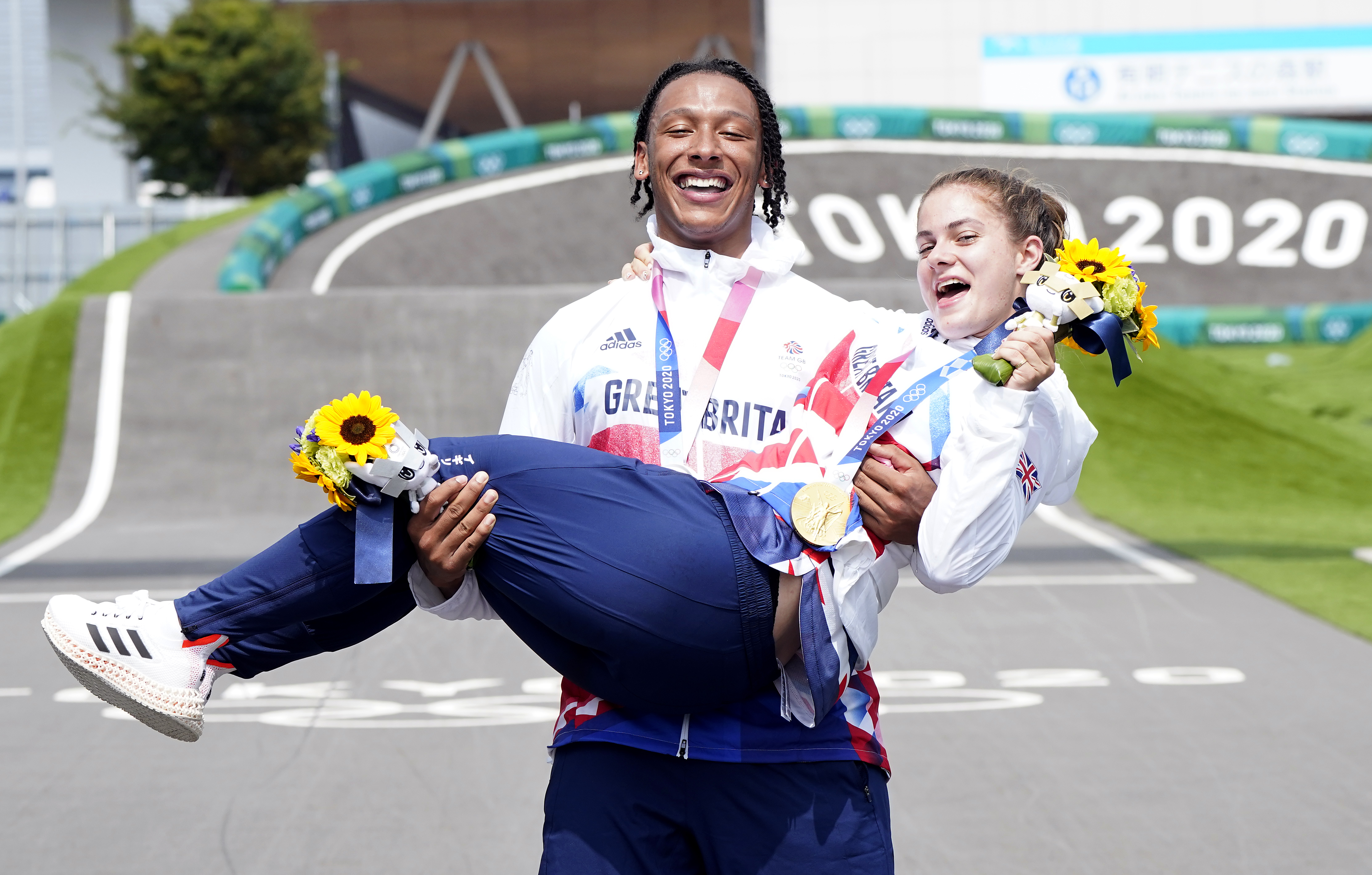 Bethany Shriever and Kye Whyte celebrate their medals