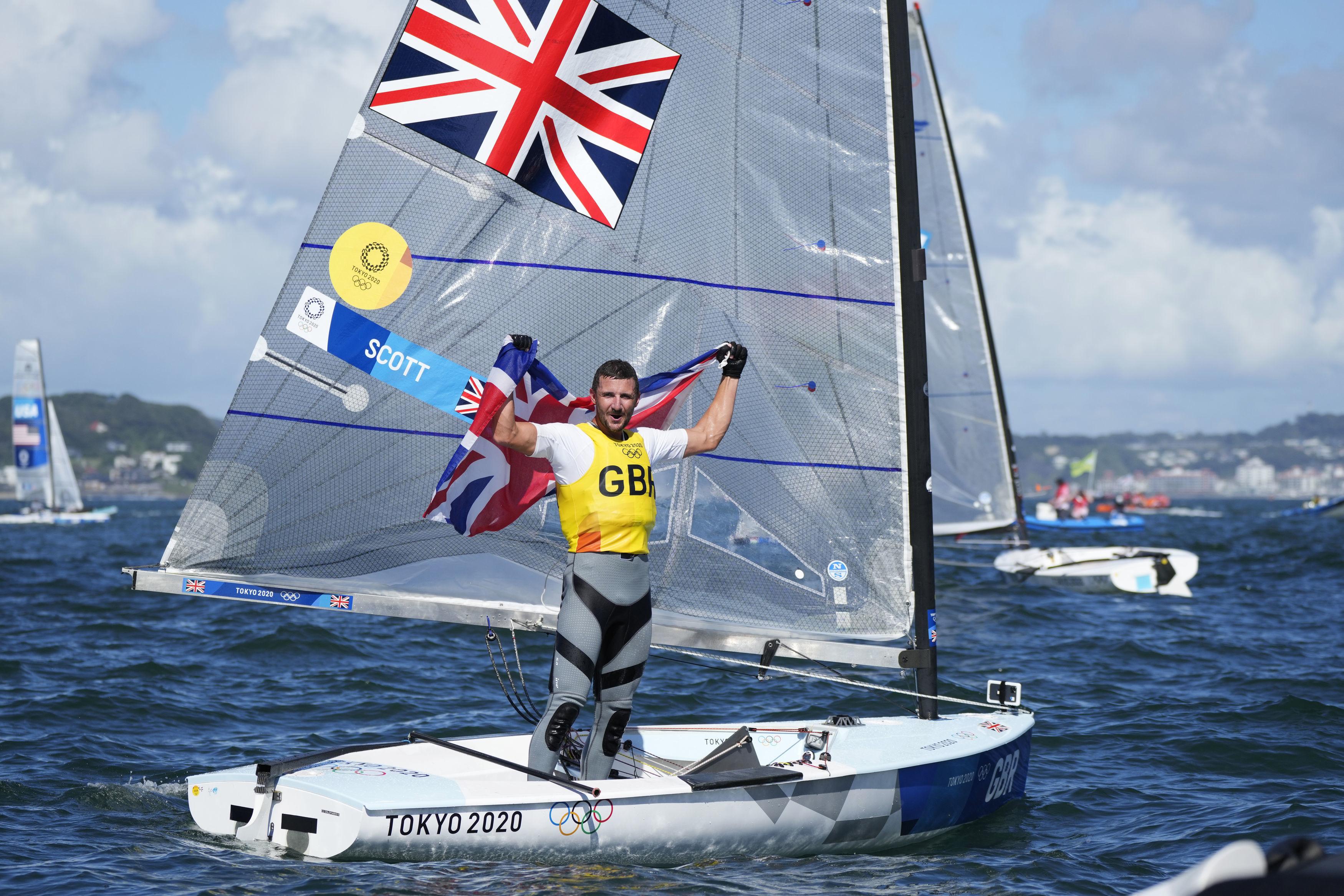 Giles Scott celebrates winning gold