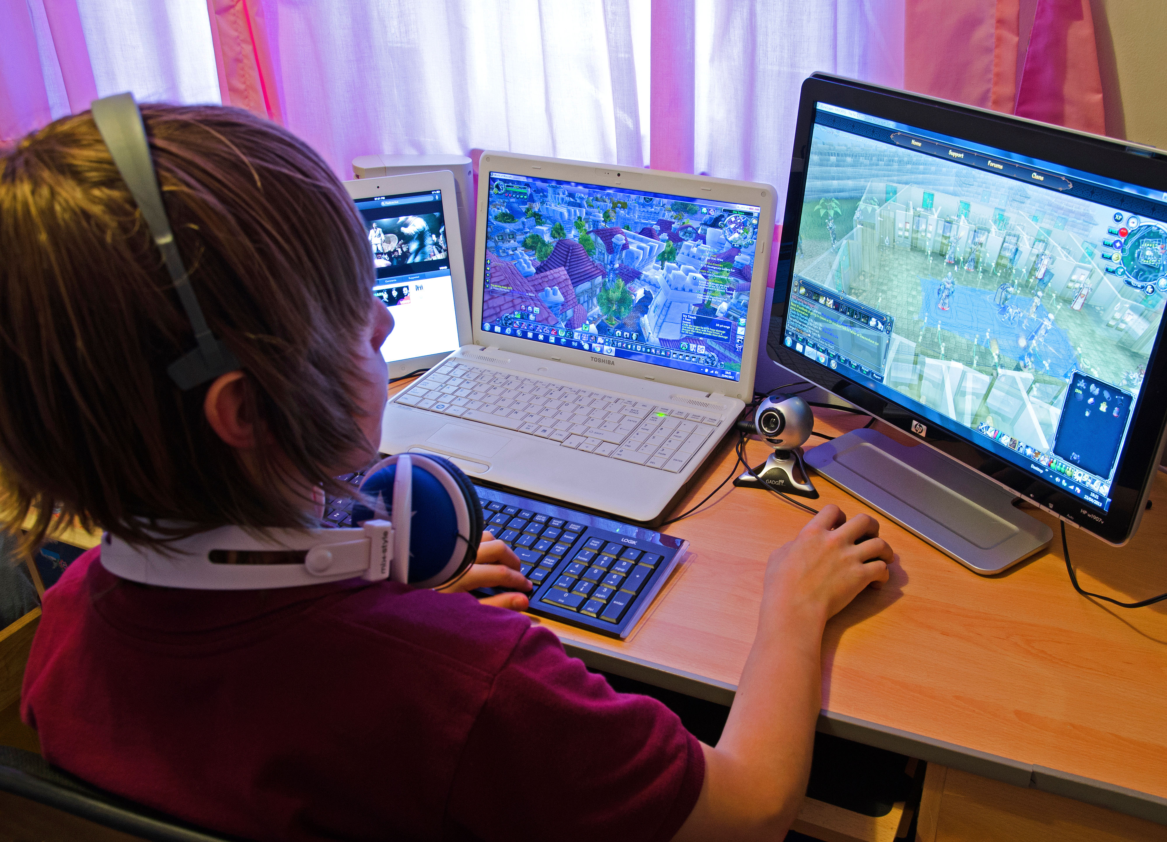 a child gaming on a pc