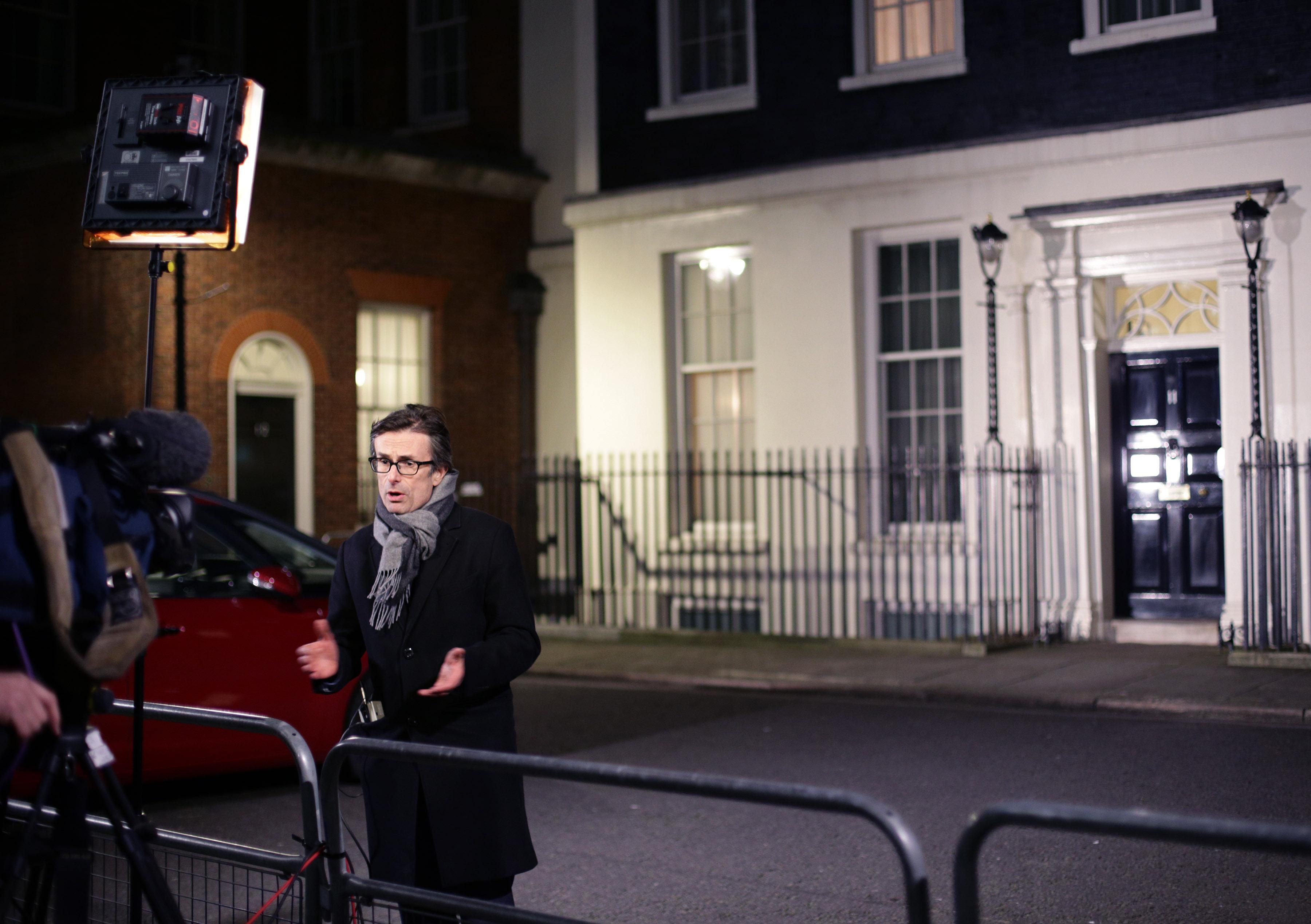 Robert Peston filming outside Downing Street